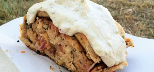 Handbrot or Rahmklecks, German street food on festivals and Christmas markets. Filled bread with ham and cheese