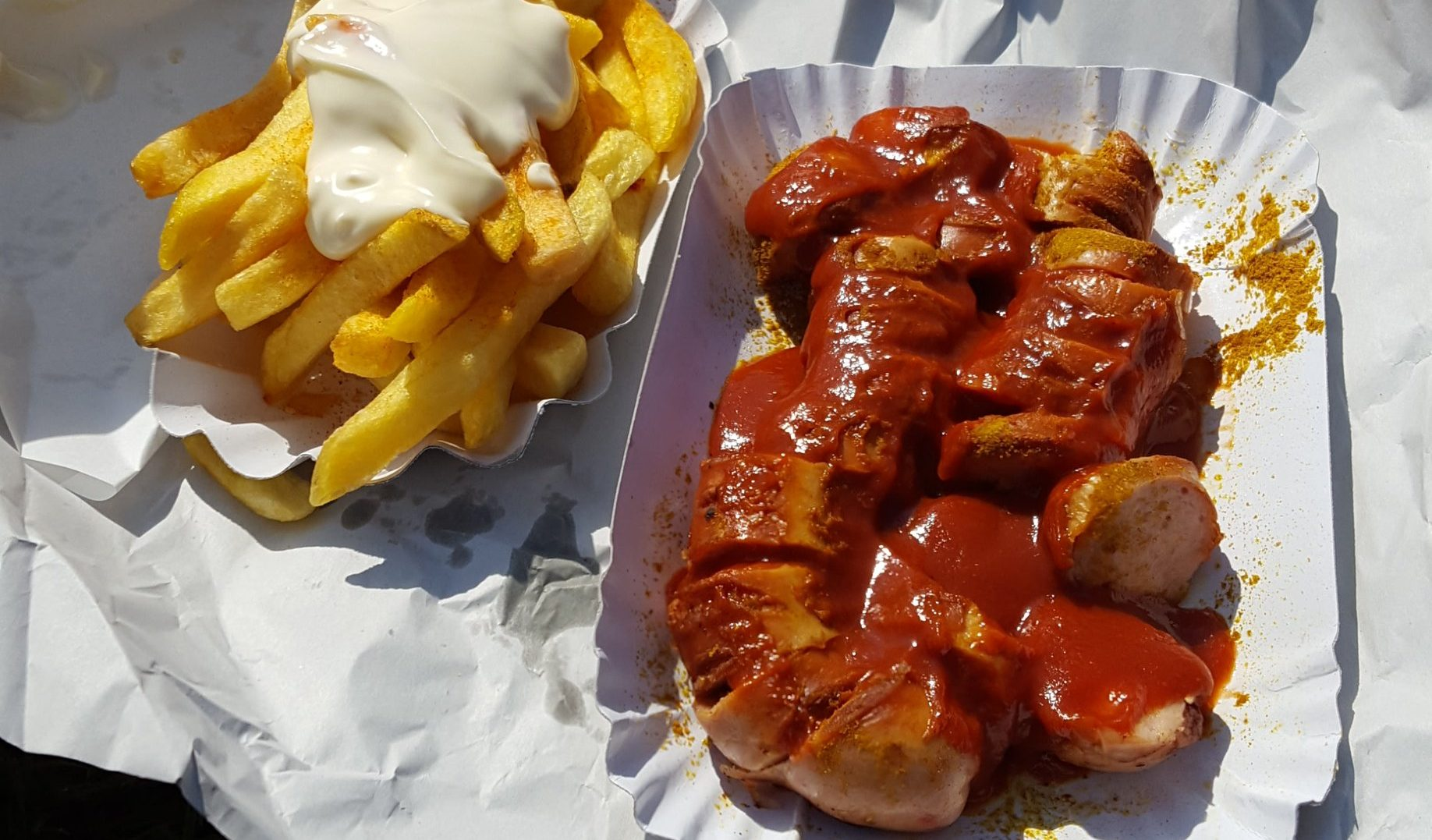 Currywurst mit Pommes, traditional Berlin curry sausage with fries from Curry 61 in Mitte